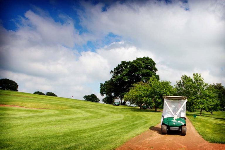 bride and groom in golf buggy at The Nottingham