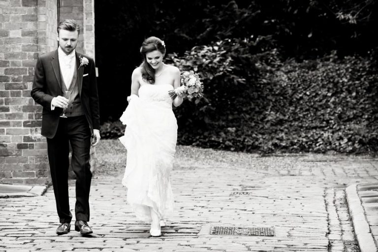 bride and groom walking to meal at norwood park