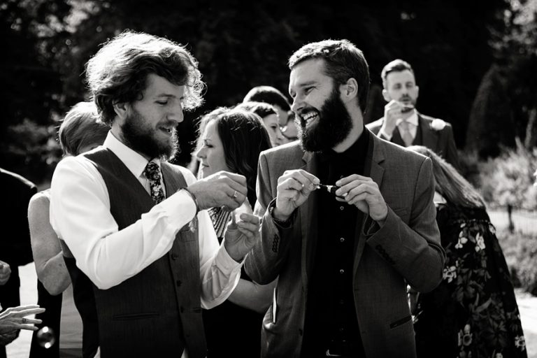 guests smiling and blowing bubbles at wedding