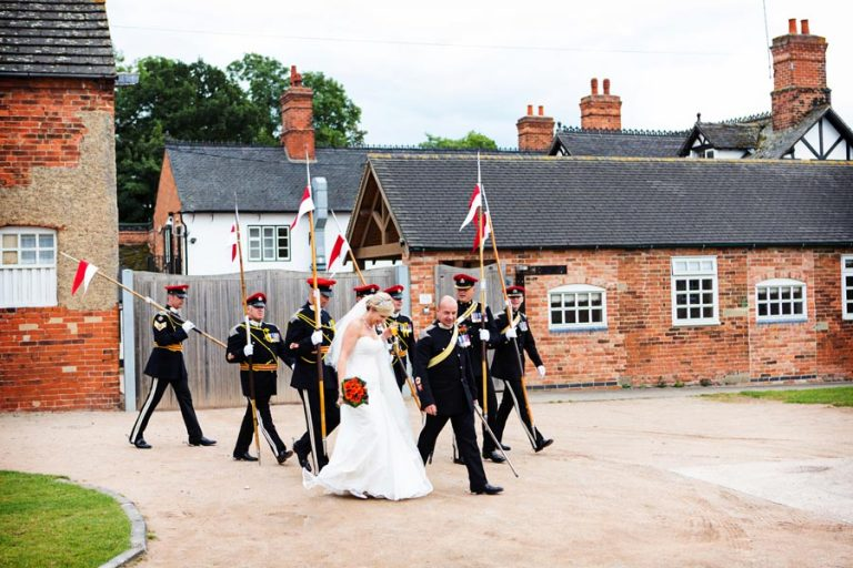 bride and groom with army friends