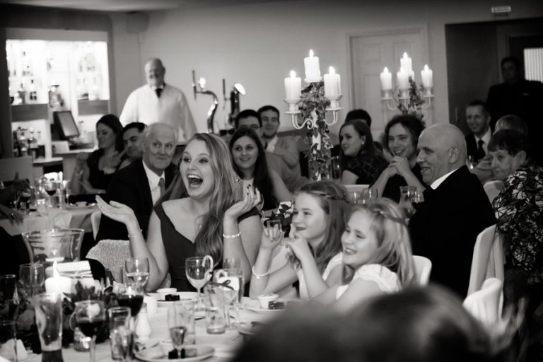 guest laughing during speeches at kelham hall