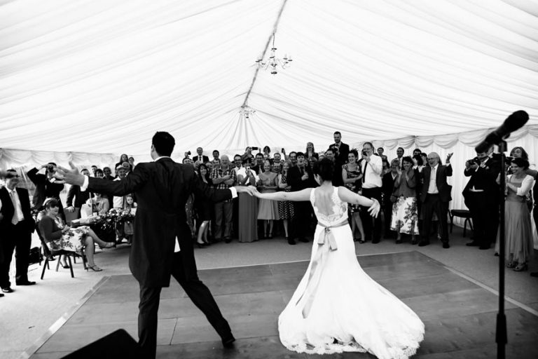 bride and groom dancing in marquee at The Old Palace Lincoln