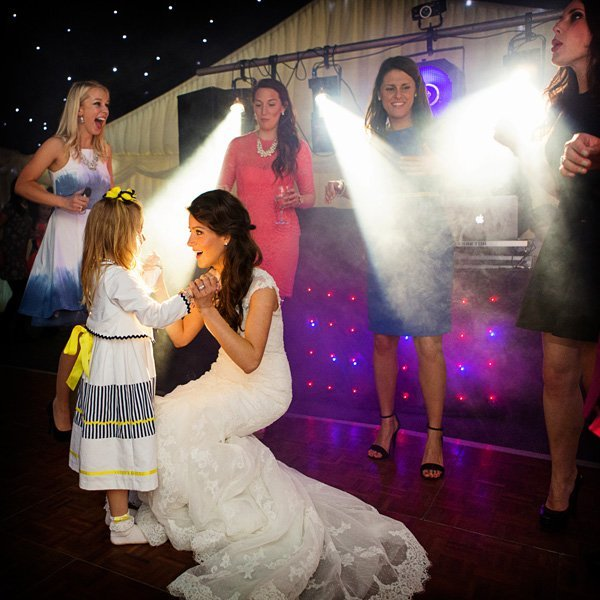 bride and girl dancing at wedding in marquee Nottinghm