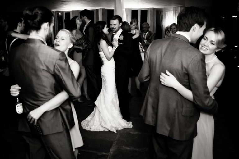 bride and groom dancing with guests at norwood park