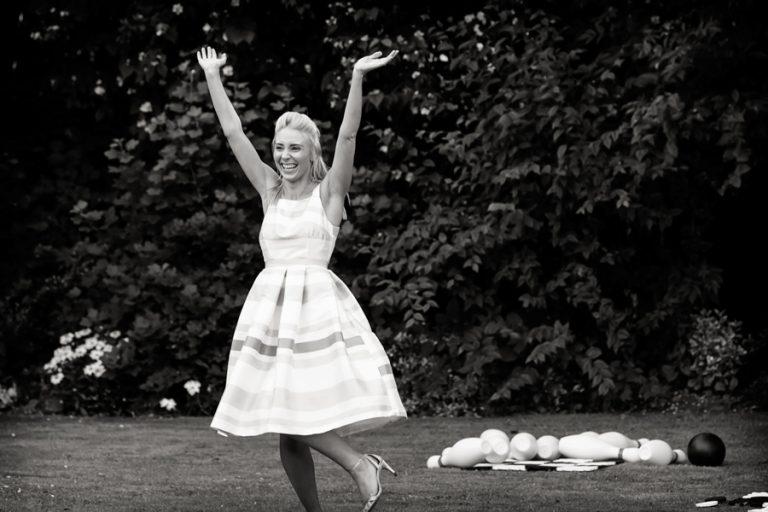 lady cheering at wedding garden games