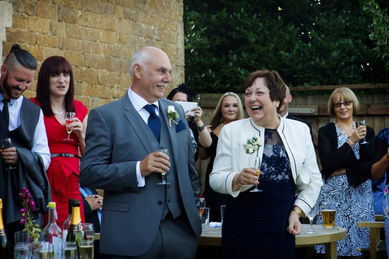 wedding guests laughing during speeches at Alllington Hall