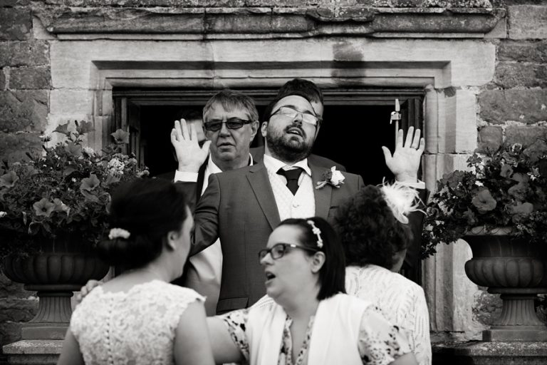 good pulling funny expression walking out to wedding guests in garden