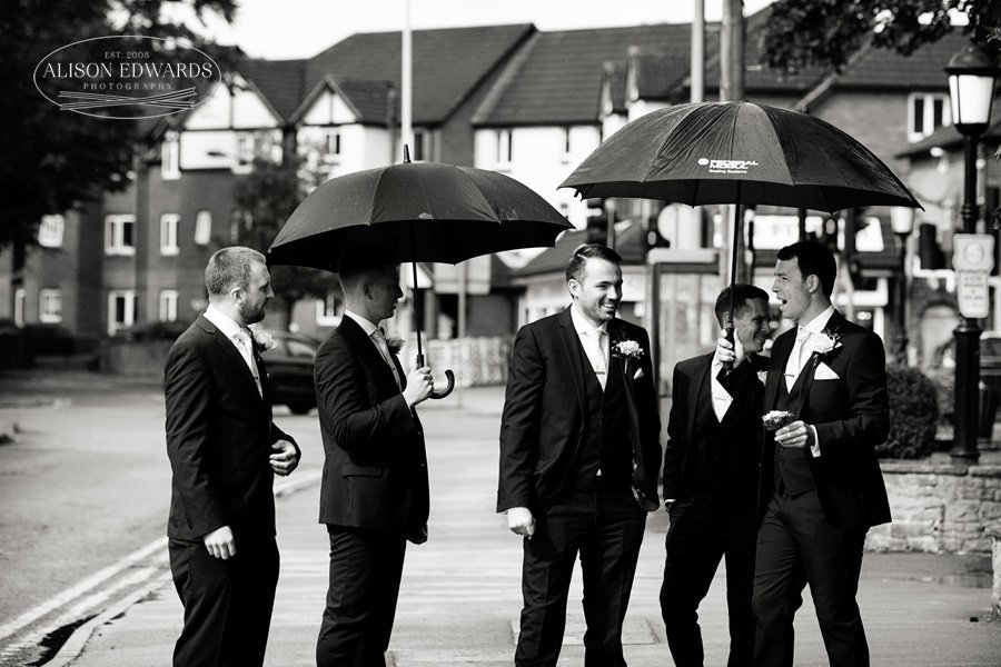 groom and groomsmen leaving pub going to church