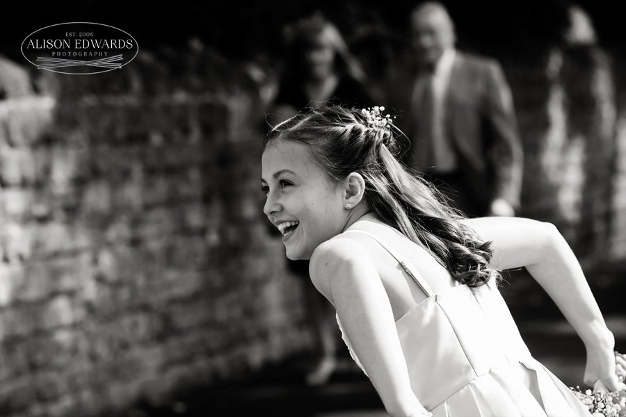 bridesmaid laughing outside of church