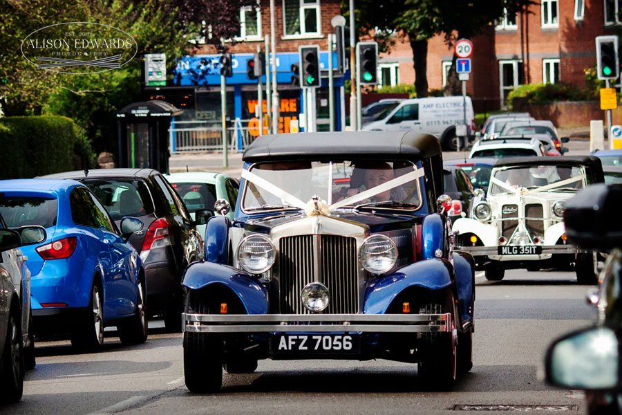 blue wedding car arriving at church
