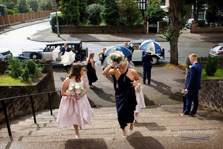 bridesmaids walking up the steps to church