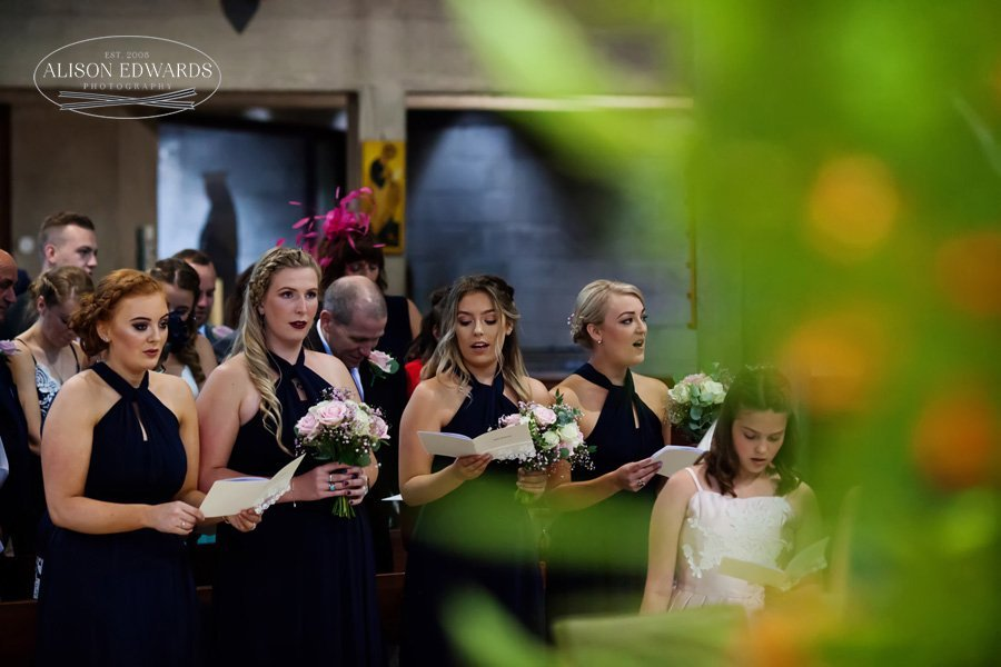 bridesmaids singing in church