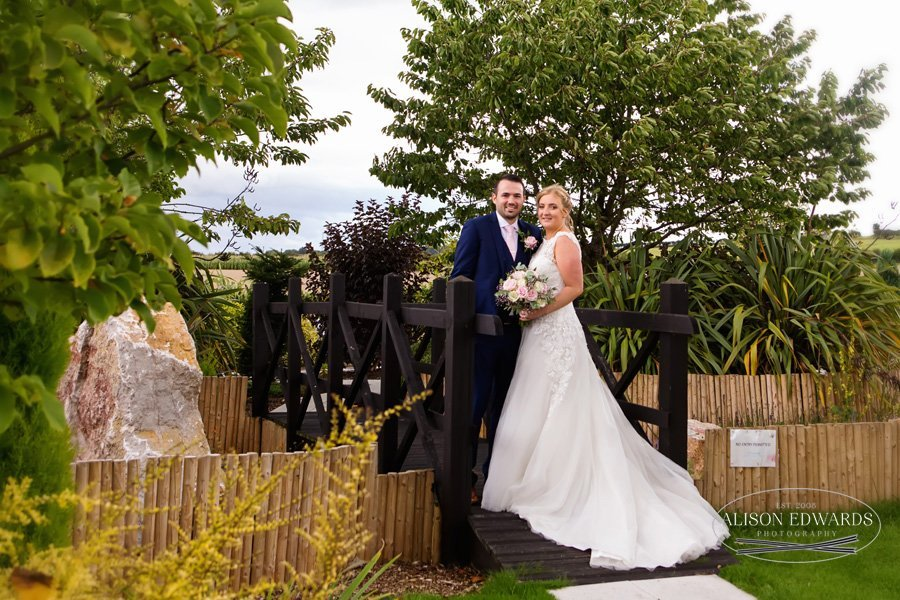 bride and groom on bridge at Goosedale