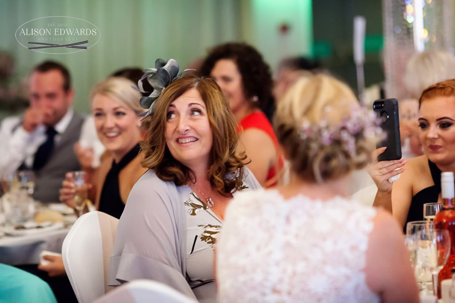 bride's mum smiling during speeches