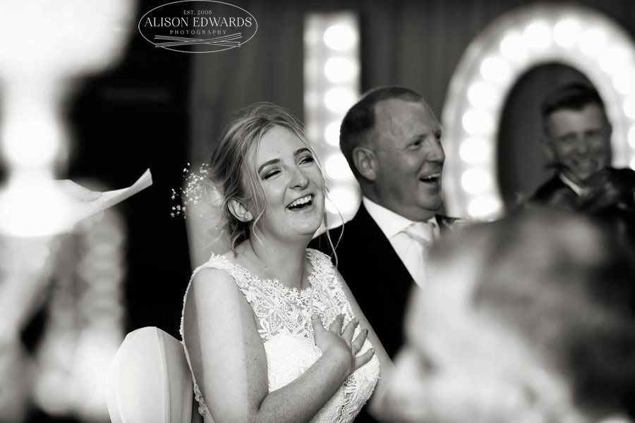 bride and father laughing during spheres