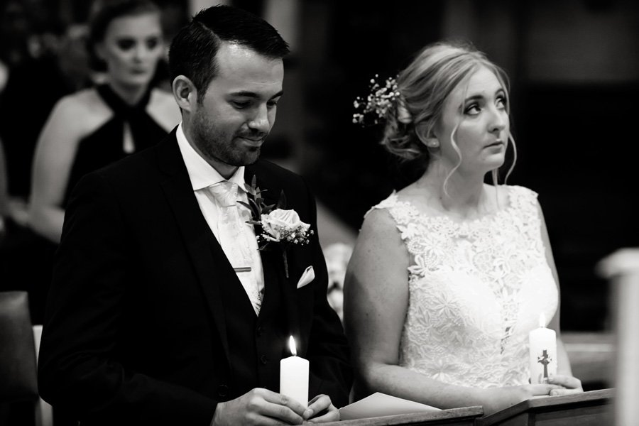 bride and groom kneeling in Nottingham church