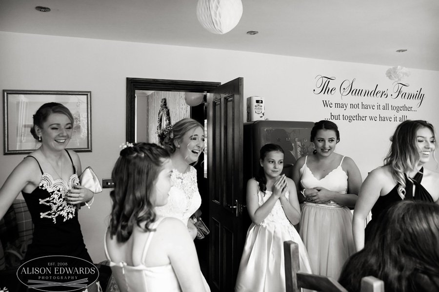bride and friends laughing in kitchen