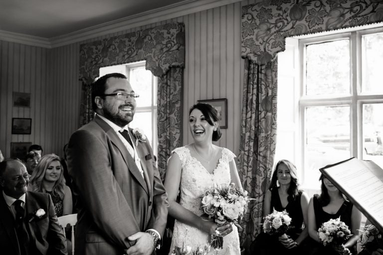 bride and groom laughing during ceremony at Allington Manor