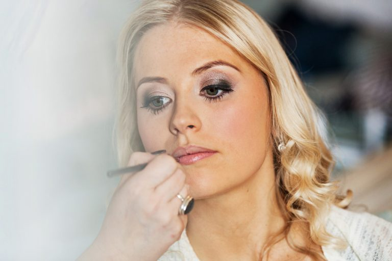close up photo of bride having her make up done