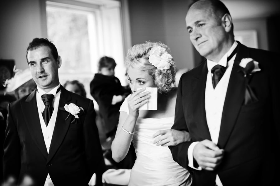 bride wiping tear from eye with dad at Shottle Hall