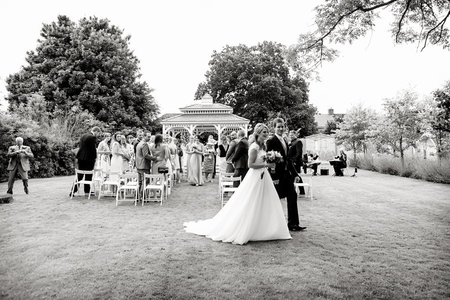bride and groom walking away from ceremony at Old Vicarage Hotel