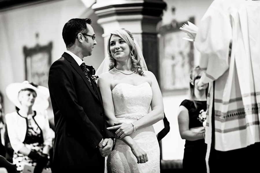 bride and groom looking lovingly at each other during ceremony