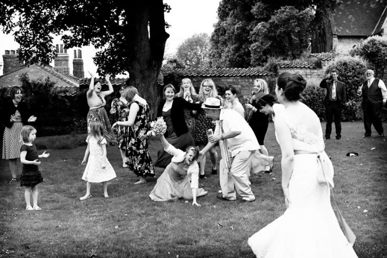 bridesmaid falling over to catch bouquet
