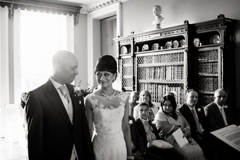 bride and groom at Prestwold Hall smiling at each other