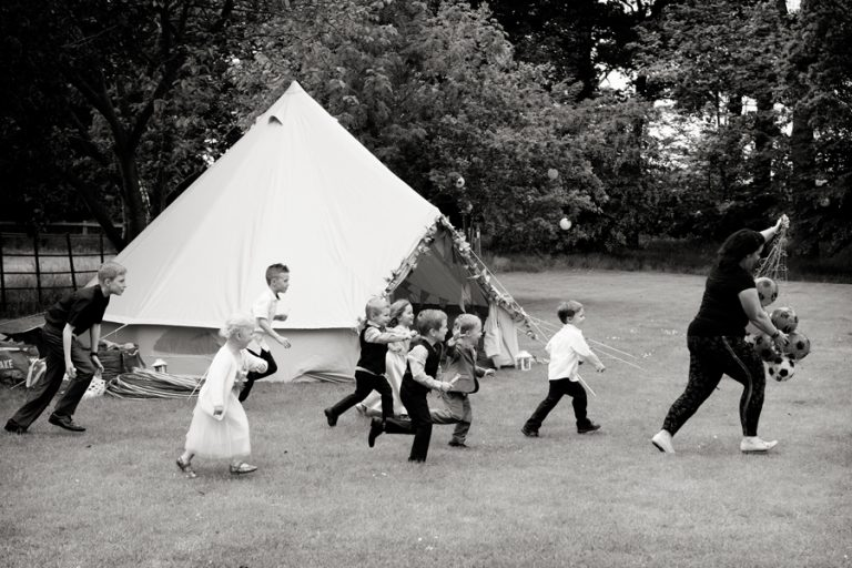 children running and playing at wedding reception
