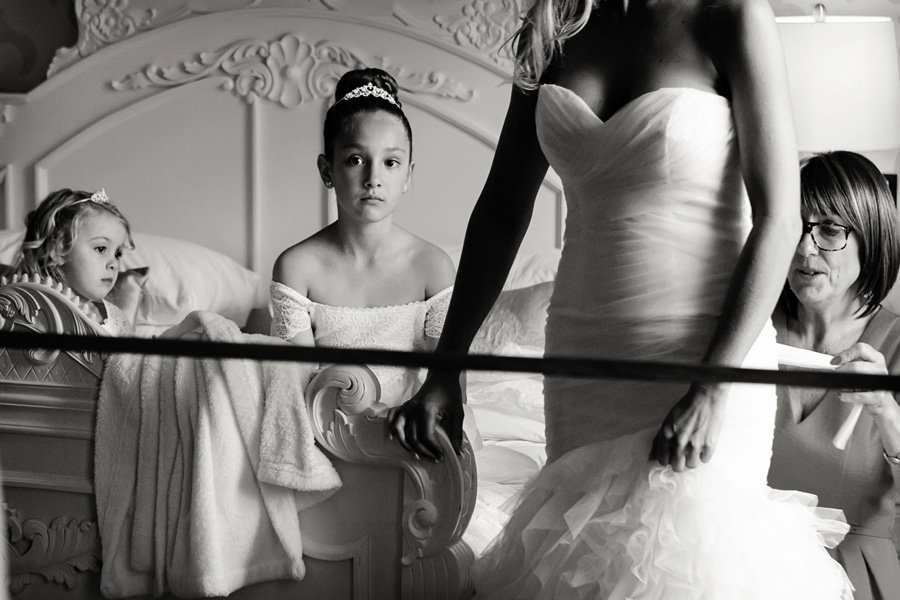 bride and bridesmaid's reflection in mirror -The Old Vicarage Boutique Wedding Photographer