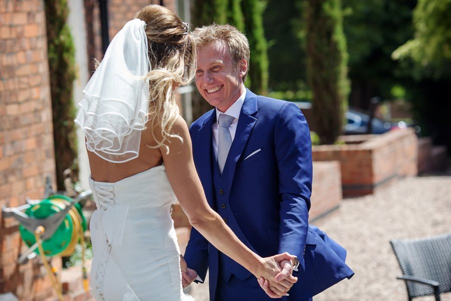 groom smiling at bride after wedding ceremony The Old Vicarage Boutique Wedding Photographer