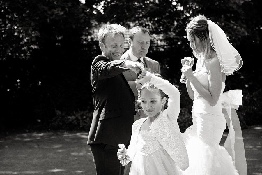 groom and daughter dancing in gardens