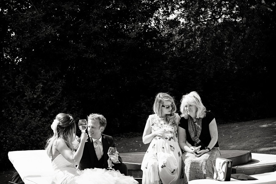 wedding guests sitting in sun at Old Vicarage Boutique Hotel