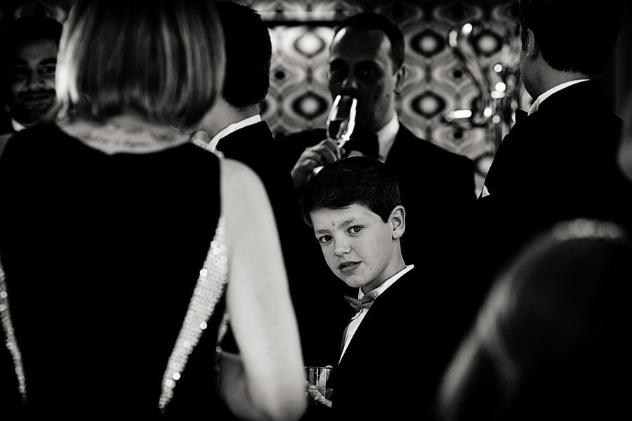 young boy looking during wedding speeches