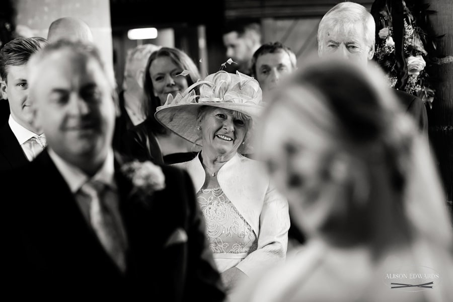 bride's mum smiling in church