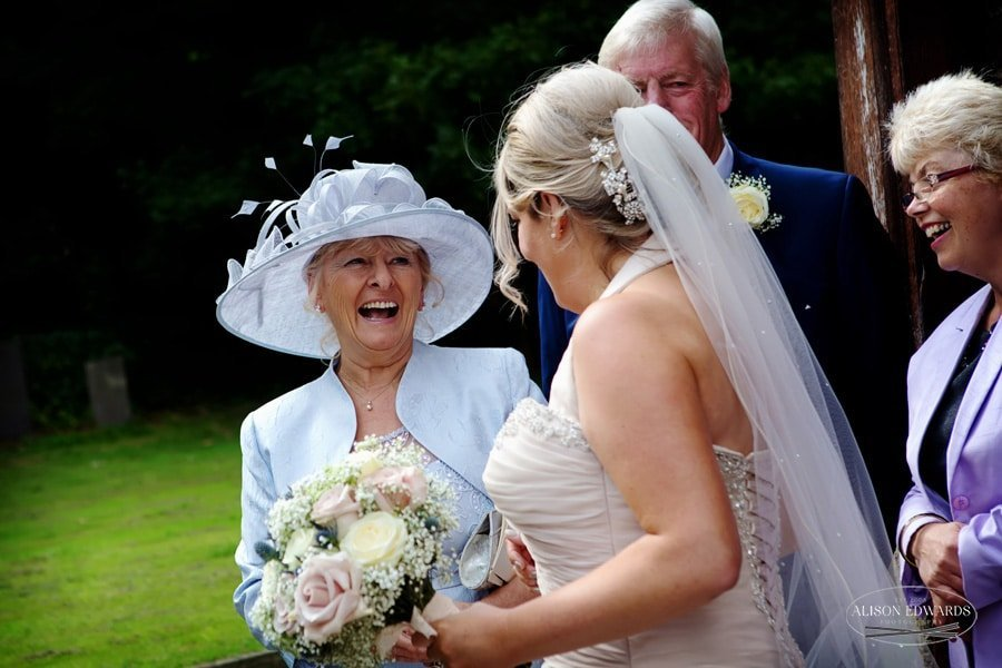 bride and mum laughing