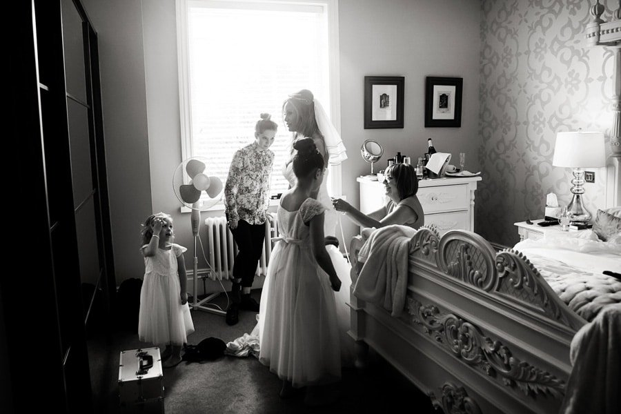 bride and bridesmaid getting in bridal suite