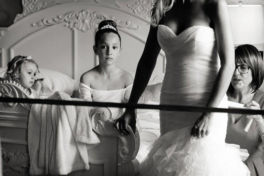 bridesmaid looking at bride in mirror at old vicarage