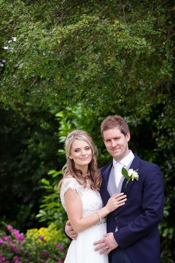 bride and groom on the steps at Old Vicarage