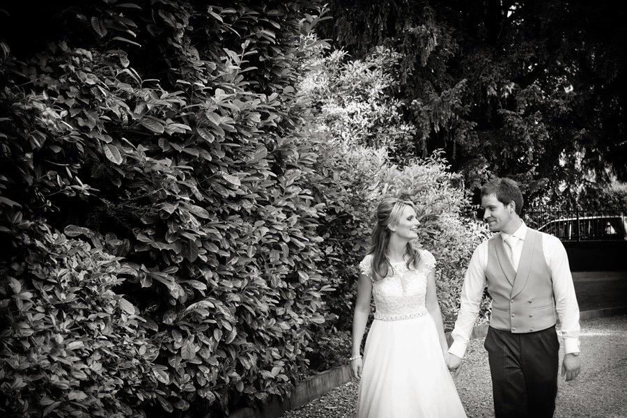 Bride and groom walking up drive at old vicarage boutique hotel