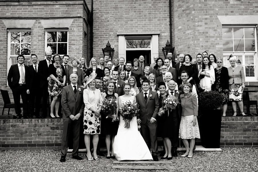 big group photo on steps at old vicarage boutique hotel