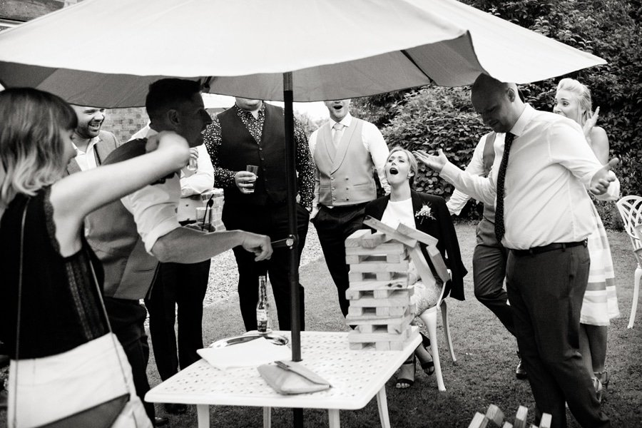 guests laughing at jenga game old vicarage boutique
