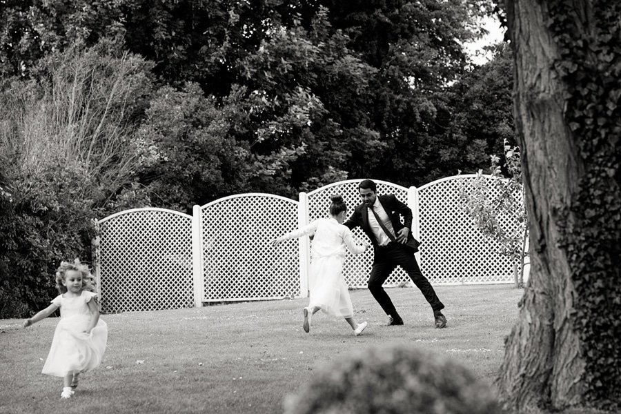 guests playing catch at wedding