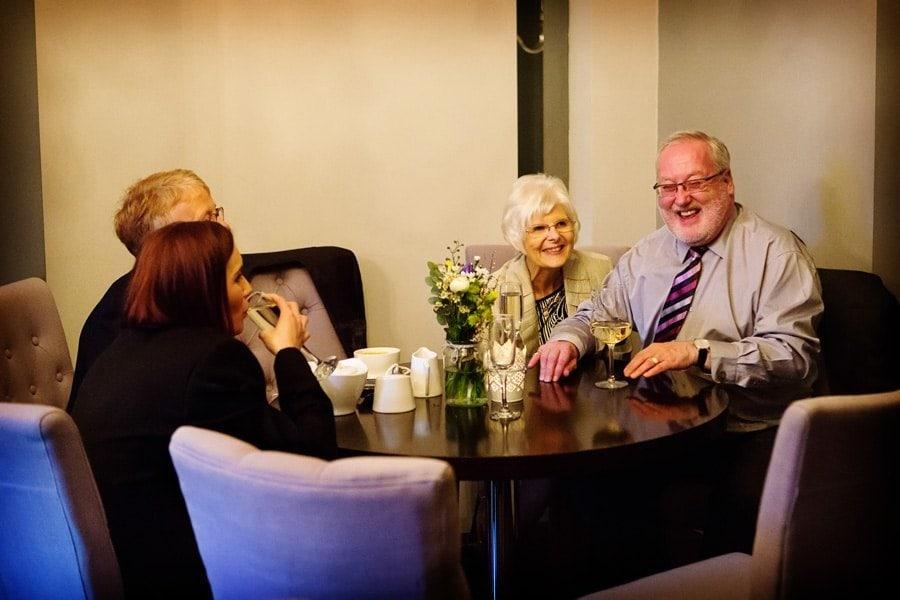 guests talking at old vicarage wedding