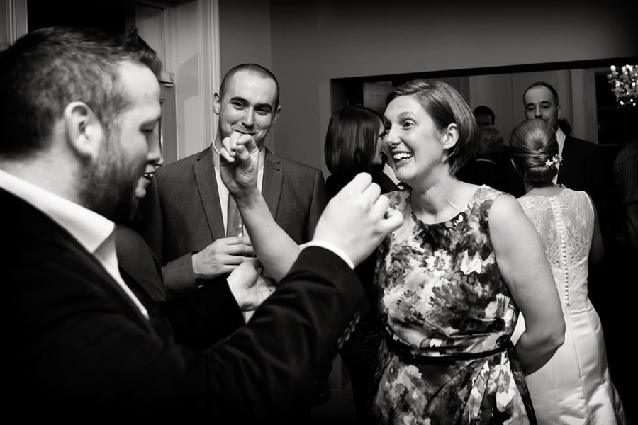 guests laughing during wedding breakfast at old vicarage