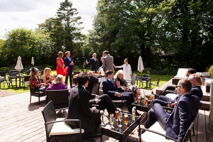 wedding guests sitting in gardens at old vicarage boutique