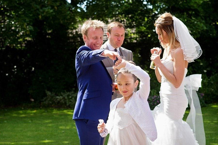 groom dancing with bridesmaid in gardens