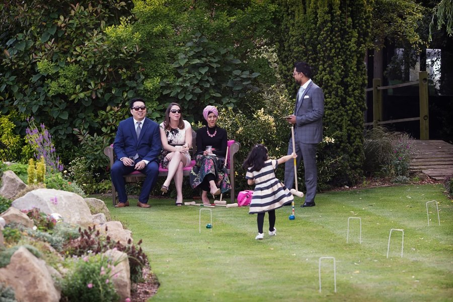 guests playing garden games at Floral Media wedding photos
