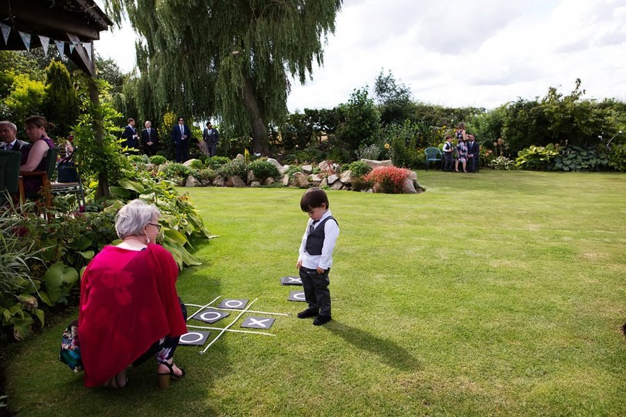 young boy sulking with wedding guest
