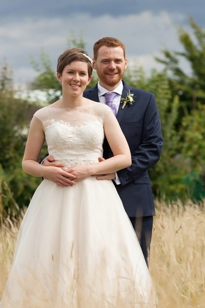 bride and groom in fields at Floral Media wedding